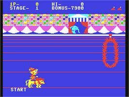 In game image of Circus Charlie on the Commodore 64.