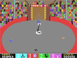 In game image of Circus Games on the Commodore 64.