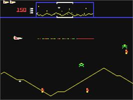 In game image of Defender on the Commodore 64.