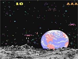 In game image of Demon Attack on the Commodore 64.