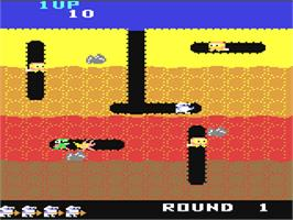 In game image of Dig Dug on the Commodore 64.
