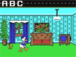 In game image of Donald's Alphabet Chase on the Commodore 64.