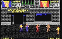 In game image of Double Dragon III: The Sacred Stones on the Commodore 64.