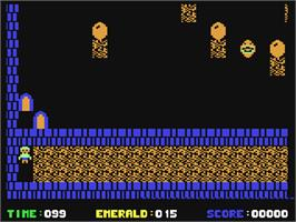 In game image of Emerald Mine on the Commodore 64.