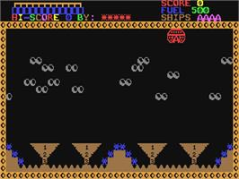 In game image of Galactic Attack on the Commodore 64.