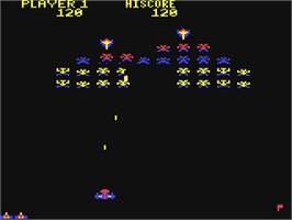 In game image of Galaxian on the Commodore 64.