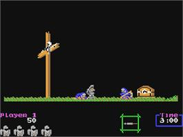 In game image of Ghouls'n Ghosts on the Commodore 64.