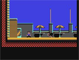 In game image of Hudson Hawk on the Commodore 64.