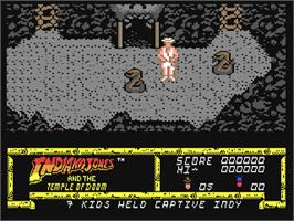 In game image of Indiana Jones and the Temple of Doom on the Commodore 64.