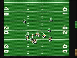 In game image of John Madden Football on the Commodore 64.