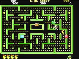 In game image of Jr. Pac-Man on the Commodore 64.