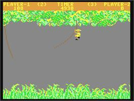 In game image of Jungle Hunt on the Commodore 64.