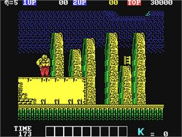 In game image of Karnov on the Commodore 64.