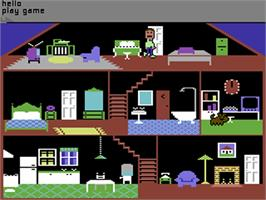 In game image of Little Computer People on the Commodore 64.