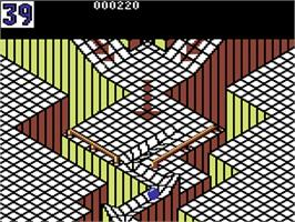 In game image of Marble Madness on the Commodore 64.