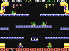 In game image of Mario Bros. on the Commodore 64.