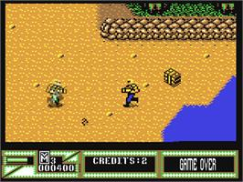 In game image of Mercs on the Commodore 64.