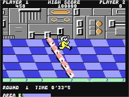 In game image of Metro Cross on the Commodore 64.