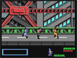 In game image of Midnight Resistance on the Commodore 64.