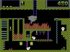 In game image of Montezuma's Revenge on the Commodore 64.