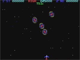 In game image of Moon Cresta on the Commodore 64.