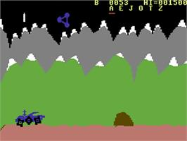 In game image of Moon Patrol on the Commodore 64.