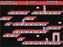 In game image of Ollie's Follies on the Commodore 64.