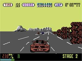 In game image of OutRun on the Commodore 64.