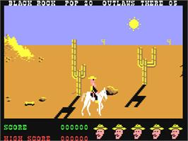 In game image of Outlaws on the Commodore 64.