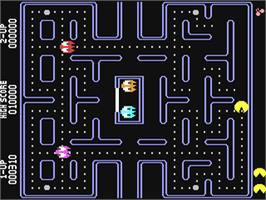 In game image of Pac-Man on the Commodore 64.