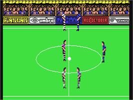In game image of Peter Beardsley's International Football on the Commodore 64.