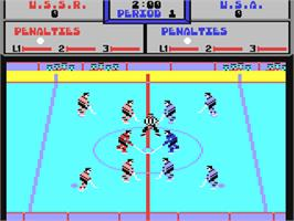 In game image of Powerplay Hockey on the Commodore 64.