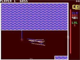 In game image of QIX on the Commodore 64.