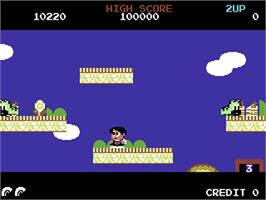 In game image of Rainbow Islands on the Commodore 64.