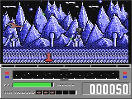 In game image of Revenge of Defender on the Commodore 64.