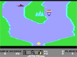 In game image of River Raid on the Commodore 64.
