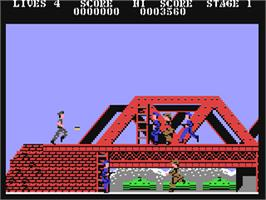 In game image of Rush'n Attack on the Commodore 64.