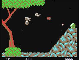In game image of Saint Dragon on the Commodore 64.