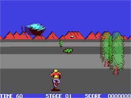 In game image of Space Harrier on the Commodore 64.