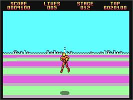 In game image of Space Harrier II on the Commodore 64.