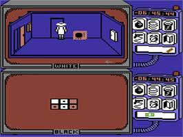 In game image of Spy vs Spy: The Island Caper on the Commodore 64.