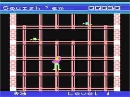 In game image of Squish 'Em on the Commodore 64.
