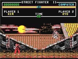 In game image of Street Fighter II on the Commodore 64.
