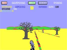 In game image of Super Hang-On on the Commodore 64.
