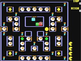 In game image of Super Pac-Man on the Commodore 64.