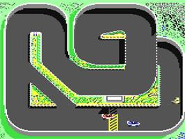 In game image of Super Sprint on the Commodore 64.