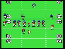 In game image of TV Sports: Football on the Commodore 64.
