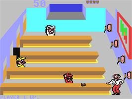 In game image of Tapper on the Commodore 64.