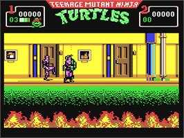 In game image of Teenage Mutant Ninja Turtles II: The Arcade Game on the Commodore 64.