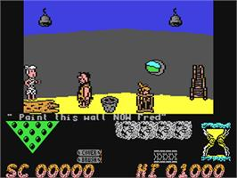 In game image of The Flintstones on the Commodore 64.